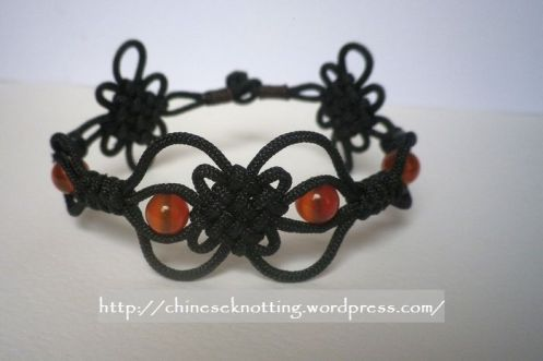 Black cord and red agate beads