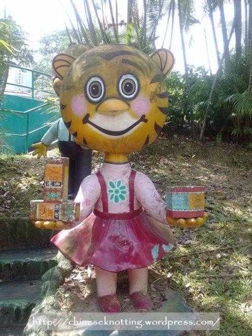 Cute tiger selling Tiger Balm